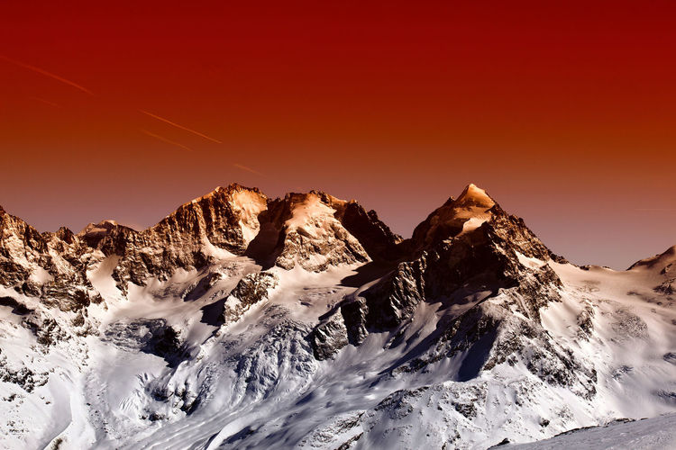 A view of fantastic colorized mountains in the Switzerland Scenics - Nature Mountain Beauty In Nature Sky Winter Snow Environment Tranquil Scene Landscape Mountain Range Tranquility Cold Temperature Nature Non-urban Scene Majestic Idyllic Sunset No People Extreme Terrain Snowcapped Mountain Mountain Peak Outdoors Dramatic Landscape