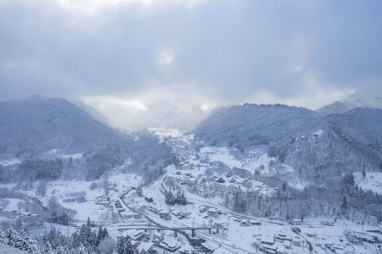 Snow Winter Cold Temperature Mountain City Environment Landscape Nature Scenics - Nature Architecture Cloud - Sky Sky Beauty In Nature Travel Holiday No People Journey Building Outdoors Range Snowcapped Mountain Snowing