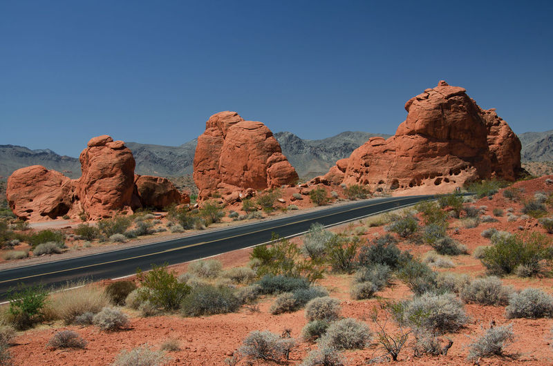 A road crossing the desert landscape in the valley of fire state park