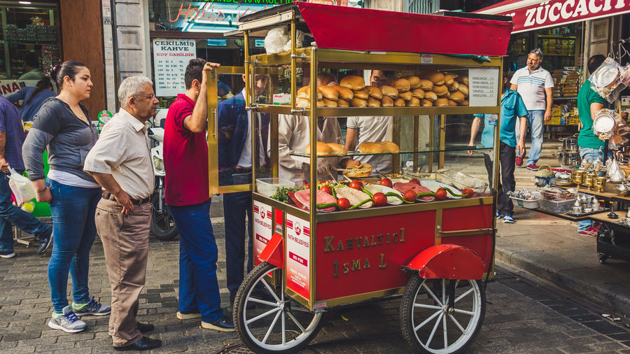 People get in the queue to buy sandwich in Istanbul. Red Cart Vendor Sandwiches People Istanbul Turkey Delicious Wait Turkish Buy