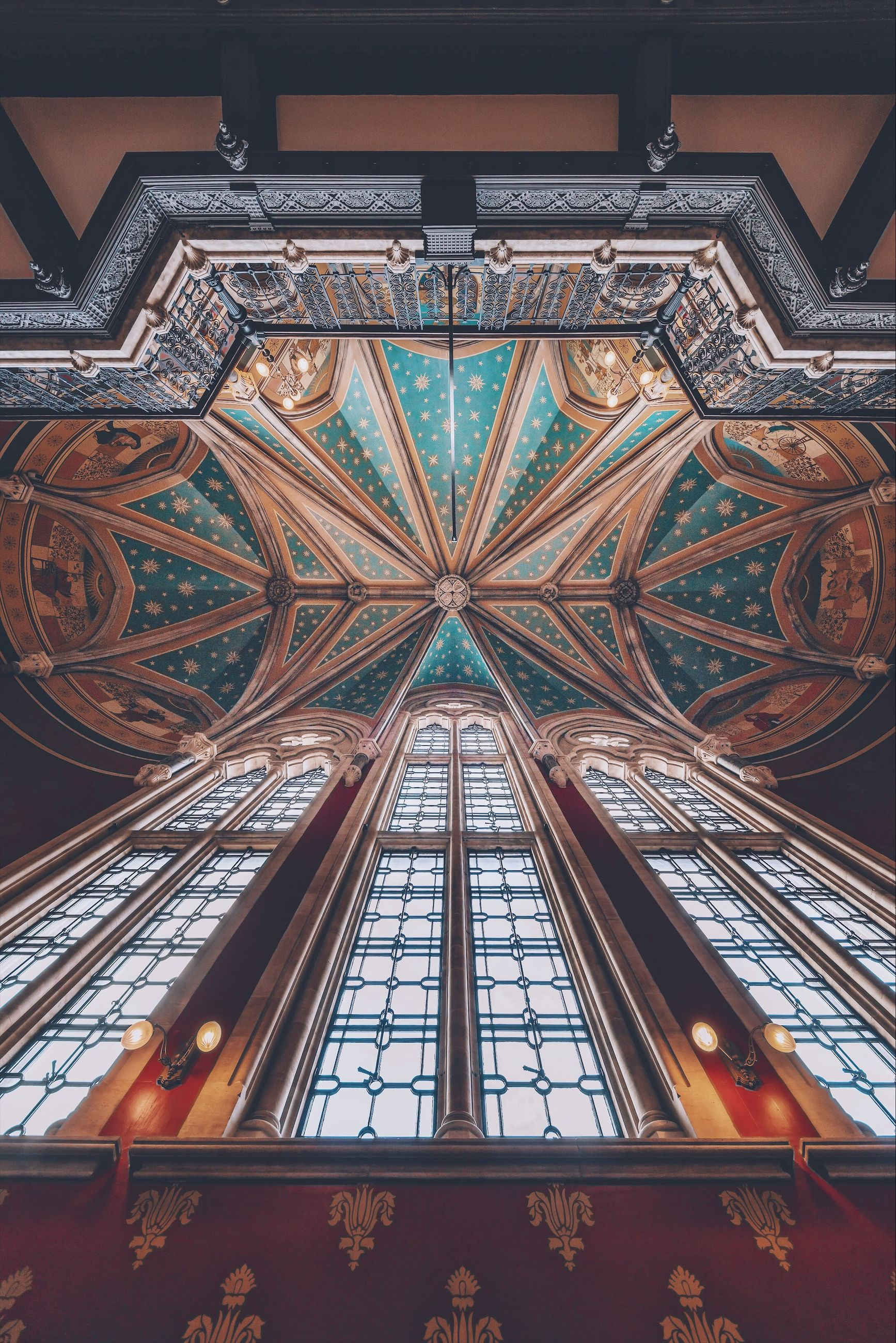 built structure, architecture, low angle view, indoors, no people, building, religion, ceiling, place of worship, glass - material, belief, spirituality, pattern, travel destinations, design, stained glass, glass, directly below, architecture and art, ornate, luxury