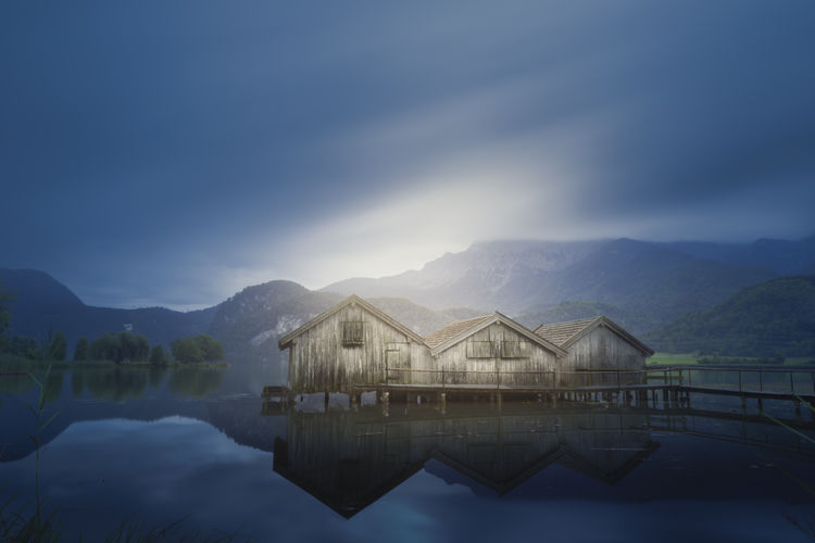 Cabins on a lake in southern germany during a cloudy summer morning. long exposure shoot