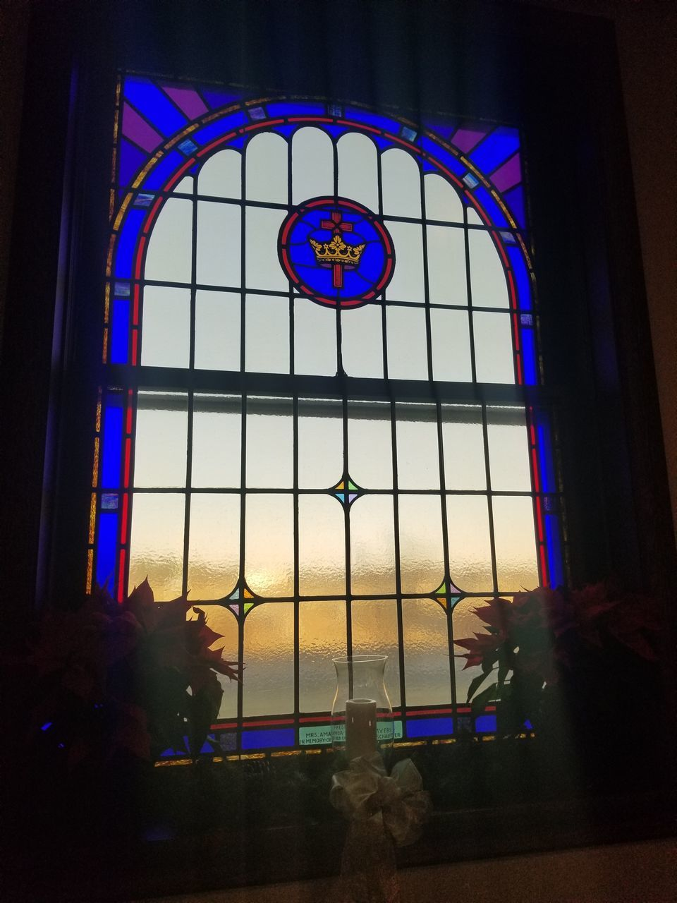 BUILDING SEEN THROUGH GLASS WINDOW OF CATHEDRAL