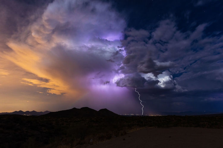 Lightning strikes from a summer, monsoon thunderstorm near Phoenix, Arizona. Beautiful Weather Background Beauty In Nature Cloud - Sky Dramatic Sky Environment Forked Lightning Landscape Lightning Lightning Bolt Mountain Nature Night No People Ominous Outdoors Power Power In Nature Purple Scenics - Nature Sky Storm Storm Cloud Thunderstorm