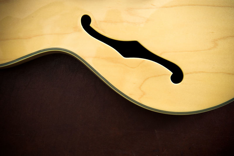Cropped Image Of Cello On Table