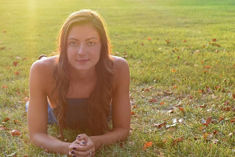 Portrait of beautiful young woman in field