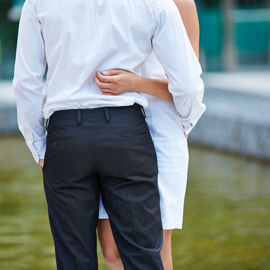 rear view of man holding woman standing against blurred background Adult Back Bum Business Businessman Businesswoman Buttocks Career Casual Clothing Couple Couple - Relationship Day Embrace Entrepreneur Focus On Foreground Formal Get Married Hand Hold Holding Hug Leisure Activity Lifestyles Love Loving Man Men Midsection Nature Outdoors Outside Partnership People Real People Rear View Romantic STAND Standing Tenderly Together Two People Valentine Day Water Wedding Woman Women