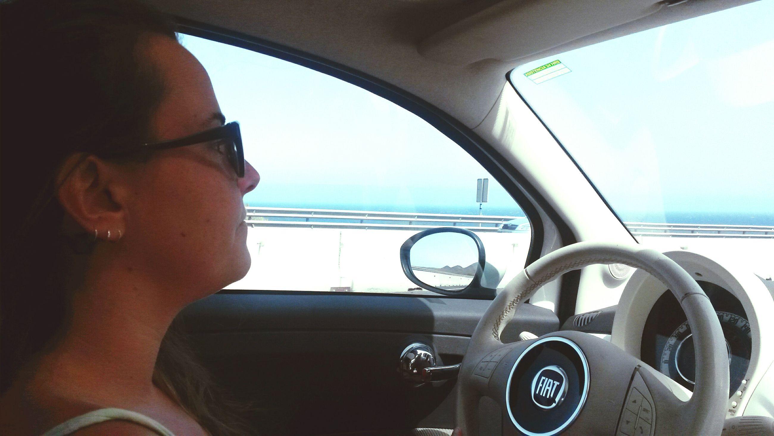 transportation, vehicle interior, mode of transport, window, indoors, travel, land vehicle, lifestyles, leisure activity, car interior, journey, car, transparent, glass - material, vehicle seat, headshot, reflection, sky