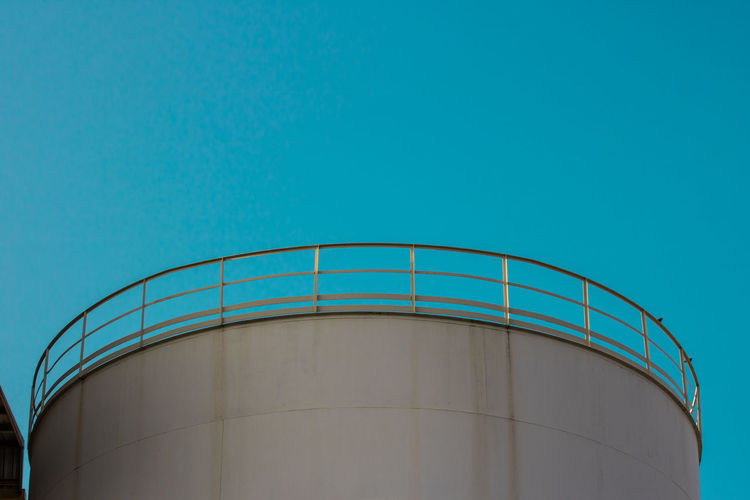 Copy Space Storage Tank Sky Architecture Low Angle View Blue Built Structure Industry Clear Sky Fuel Storage Tank Nature Storage Compartment Factory Fuel And Power Generation No People Day Silo Building Exterior Container Staircase Outdoors
