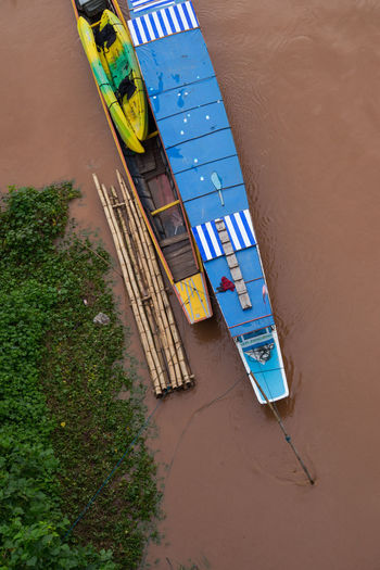 On The Water On The Way Transportation Architecture Blue Boat Boat Building Exterior Built Structure Day High Angle View Laos Nature No People Outdoors Raft River Sand Southeast Asia Southeastasia Stream Water Waterfront