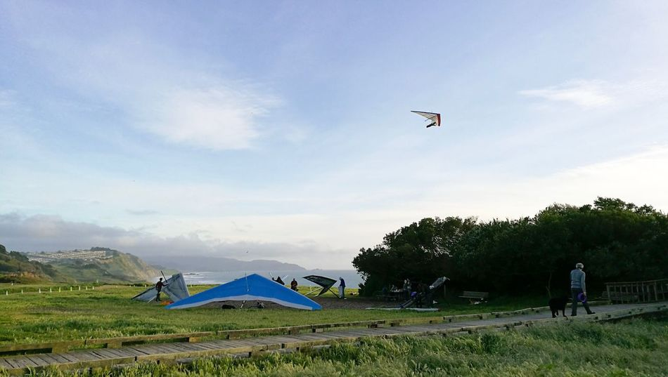 Sky Grass Tent Nature Cloud - Sky Tree Day Adventure Landscape Leisure Activity Outdoors Beauty In Nature Field Vacations Scenics Flying Paragliding Architecture No People Kite Hanggliding Hangglider