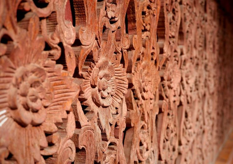 Selective focus of traditional pattern on the antique Thai style wooden fence wall craving, art and culture concept Traditional Wooden Craving Selective Focus Retro Fence Pattern Old Vintage Textured  Flowers Pattern Side View Wood Thai Culture Sculpture Dust Antique Ancient EyeEm Selects Full Frame Close-up Ancient Sculpted Historic Textured  Carving