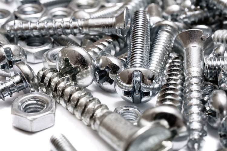 Macro Of A Big Collection Of Iron Screws, Wood Screws And Bolts Iron Wood Screws Bolt Close-up Collection High Angle View Large Group Of Objects Lying Down Many Metal Nut - Fastener Screw Woodscrew Work Tool