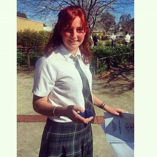 Excuse the triple post today. But I'm just so excited about finishing school. So here's a shot of me with my final report, the last time I walk out of the Xavier High Arts Centre. School Finish Yeartwelve Grownup pretty red