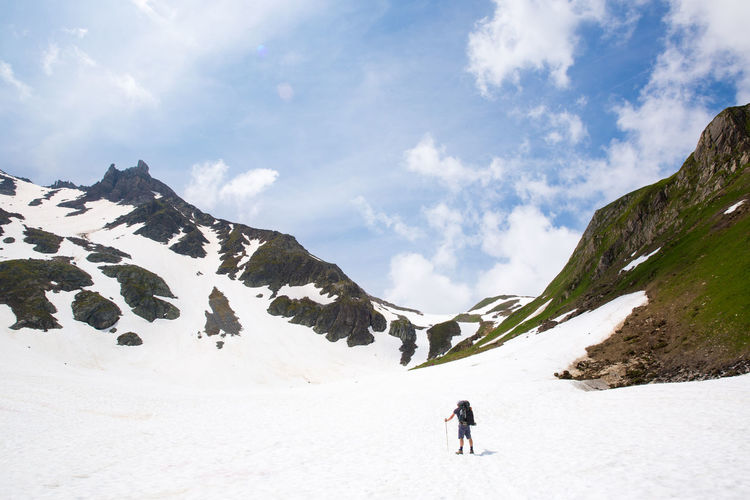 A backpacker on the Tour du Mont Blanc Backpacking Hiking Tour Du Mont Blanc Adventure Backpackingeurope Beauty In Nature French Alps Glacier Hiking Adventures Lifestyles Mountain Mountain Range Nature One Person Outdoors Scenics - Nature Snow Snowcapped Mountain Sport