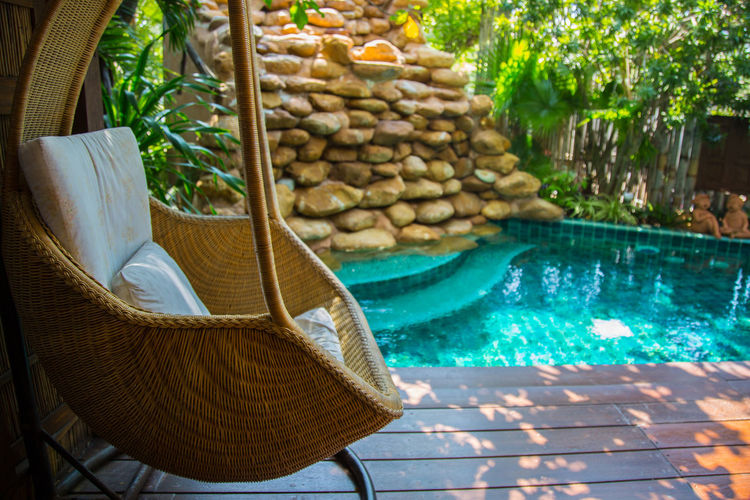 Wicker Chair At Poolside