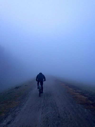 Driving Around Foggy Morning Cycling Road Landscape Adult One Person Bicycle Fog People Silhouette Adults Only Outdoors Spooky Healthy Lifestyle Beauty In Nature Scenics Nature Sky Young Adult Me Day