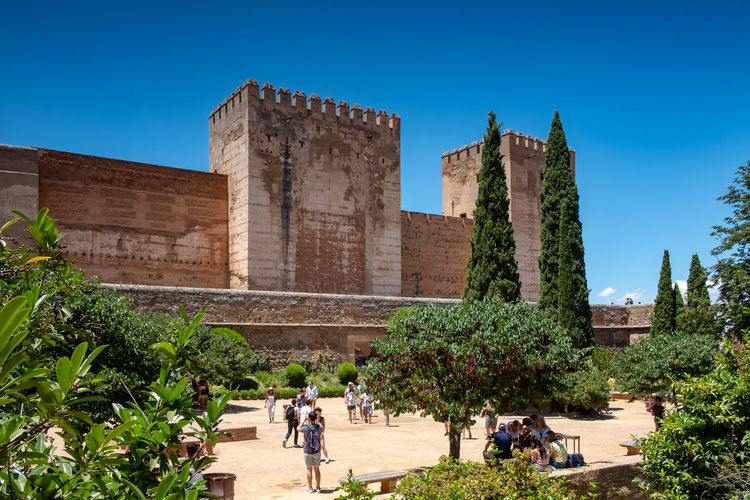 Alhambra De Granada  The Week on EyeEm Alhambra Ancient Ancient Civilization Archaeology Architecture Building Building Exterior Built Structure Clear Sky Day Group Of People History Nature Outdoors Plant Real People Sky Sunlight Tourism Travel Travel Destinations Tree Women