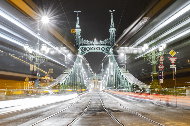 Illuminated liberty bridge at night