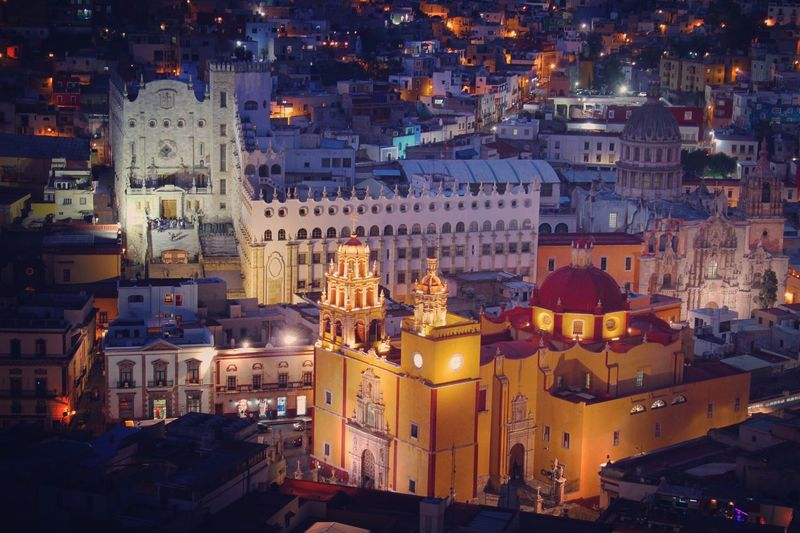 High Angle View Of Illuminated Colonial Style Buildings In City At Dusk