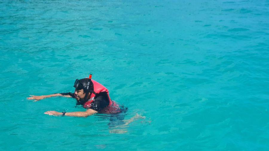 High angle view of man snorkling at sea