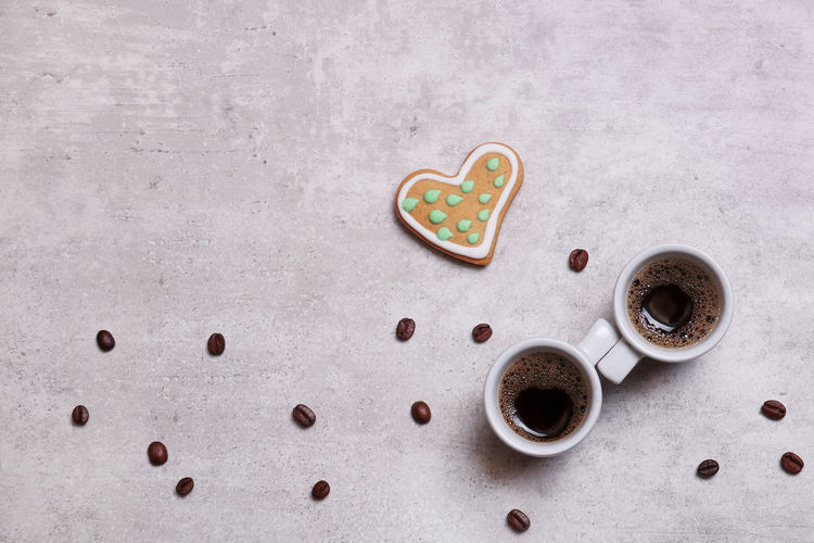Heart-shaped cookies and two cups of coffee on a table with coffee grains Coffee Theme Coffee Grains Coffee For Two Morning Coffee For You ;-) Snack Temptation Heart Shape Sweet Love Baked Drink Coffee - Drink Emotion Table Coffee High Angle View Cup Freshness Sweet Food Still Life Close-up Directly Above No People Food Indoors  Food And Drink Copy Space
