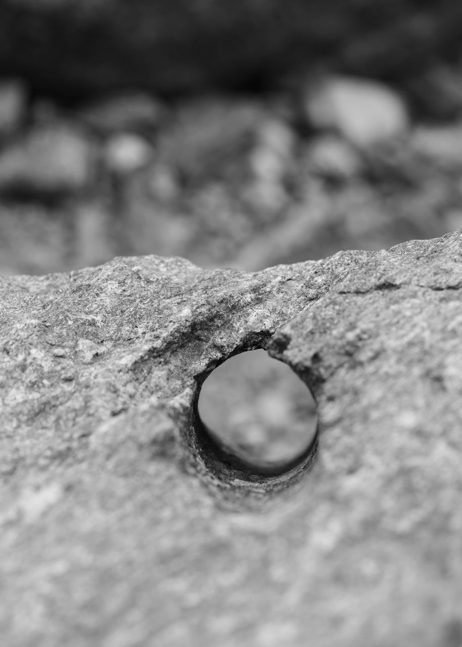 FULL FRAME SHOT OF HOLE IN ROCK