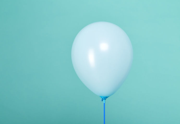 Balloon against turquoise background