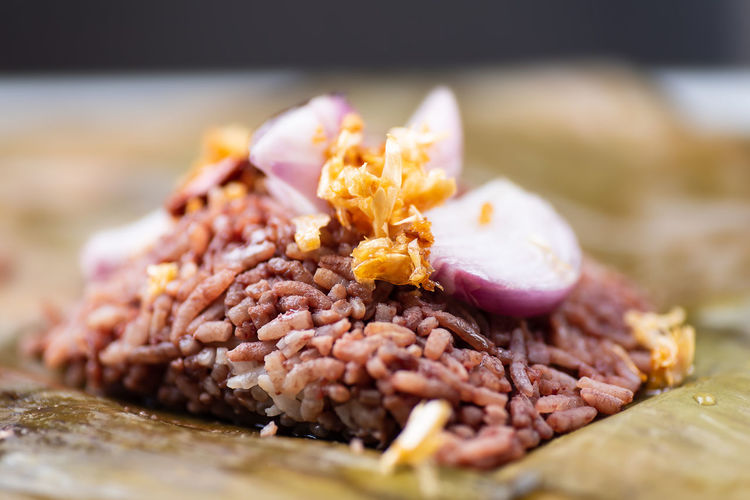 Close-up of chopped meat on cutting board