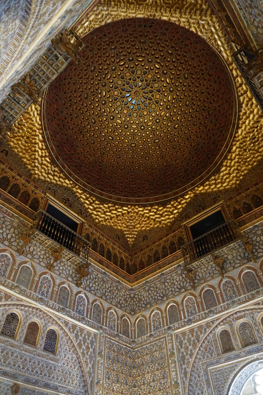 built structure, architecture, religion, indoors, low angle view, pattern, belief, building, ceiling, no people, travel destinations, arch, place of worship, design, art and craft, ornate, craft, architectural feature, directly below, architectural column, mural, floral pattern, cupola, architecture and art