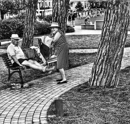 Love me always Full Length Lifestyles Childhood Tree Togetherness Leisure Activity Sitting City Playing Casual Clothing Boys Person Paving Stone Day Park - Man Made Space Outdoors Innocence City Life Footpath Park Bench Italy. Fun. Old Couple,Young At Heart