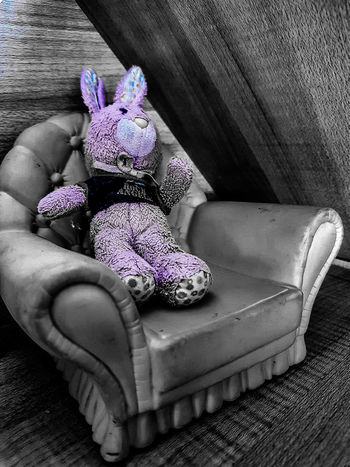 Bunny seat. Indoors  No People Close-up Backgrounds Fresh On Eyeem  Ayeshea Bah EyeEm Gallery Shadows & Light Textured  Black And White Photography Light Abstract Bunny  Soft Toy Purple Dolls House Armchair Kids Being Kids Kids Toys Kids Stuff Wood Grain Textile Cuddly Toy