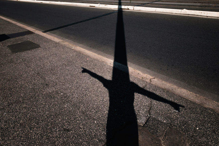 The Photographic Performing Arts Asphalt High Angle View Pedestrian Performance Road Self Portrait Shadow Streetphotography Sunlight Surface Level Urban Phenomenology