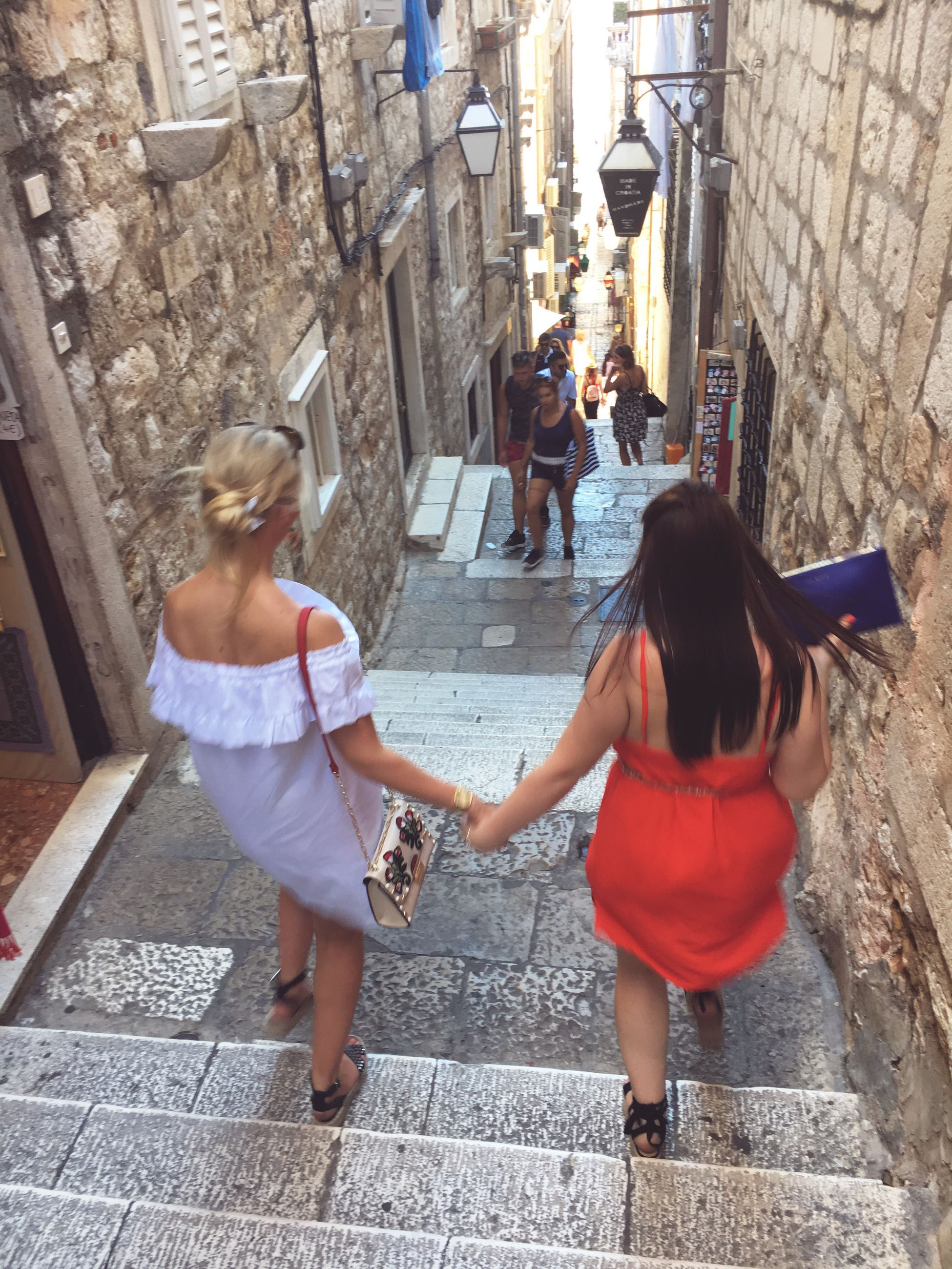 real people, architecture, built structure, building exterior, steps, lifestyles, steps and staircases, walking, full length, two people, staircase, casual clothing, street, outdoors, leisure activity, women, togetherness, day, city, men, people