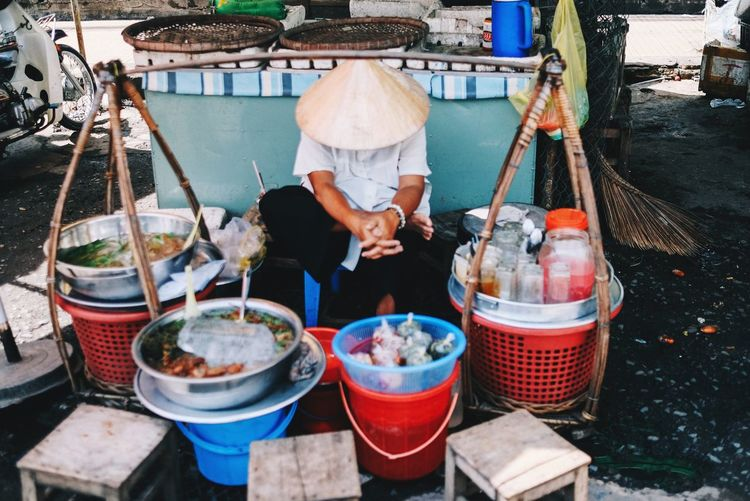 The woman who sells water falls asleep 23mm F2 Fujifilm Food And Drink Food Day Real People Freshness Container The Still Life Photographer - 2018 EyeEm Awards One Person Outdoors Market Market Stall