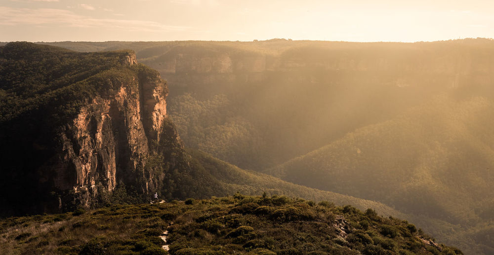 Gold haze across the Lockleys Pylon Valley in Sydney's Blue Mountains One Person Nature Human In Nature Golden Hour Sunset Mountain Adventure Cliff Landscape New South Wales  Australia Gold Light Hazy  Sky Hill Summer Field Sky Landscape