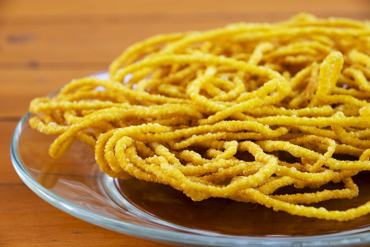 Close-up of deep fried noodles served in plate on table