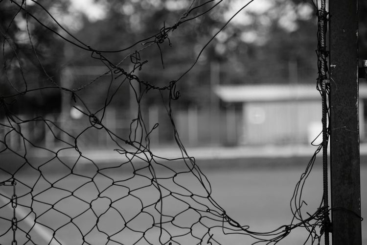Hole in fence Chainlink Fence Chainlink Hole In Fence House Black And White Focus On Foreground Protection Safety Wire Mesh