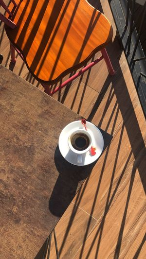 Directly above shot of coffee in cup on table