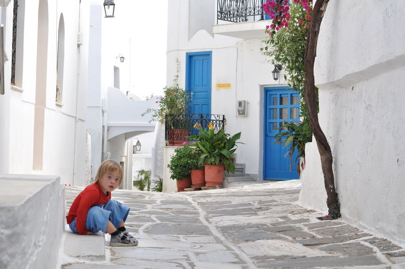 Colors Architecture Blond Hair Building Exterior Built Structure Casual Clothing Childhood Day Full Length House One Person Outdoors People Real People Sitting Smiling The Week On EyeEm