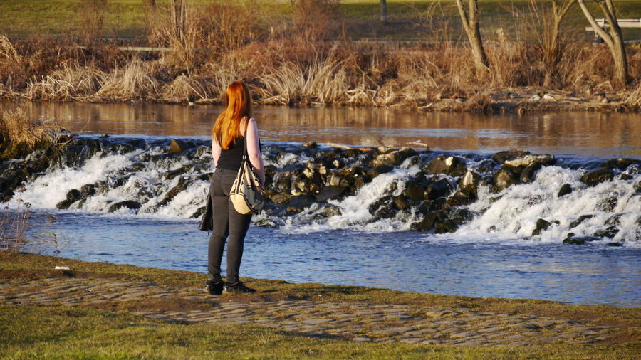 The girl with red hair watching nature Nature Real People Water One Person Standing Outdoors Beauty In Nature Stream - Flowing Water EyeEm Gallery Eyem Gallery River Ruhr  Hattingen Girl Red Hair Hair Shining With The Sun Long Goodbye Sommergefühle Sunset