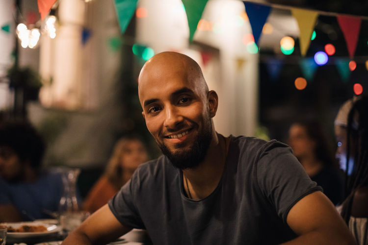 Portrait of smiling young man at restaurant
