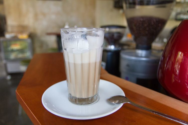 Close-Up Of Latte Macchiato In Glass On Table