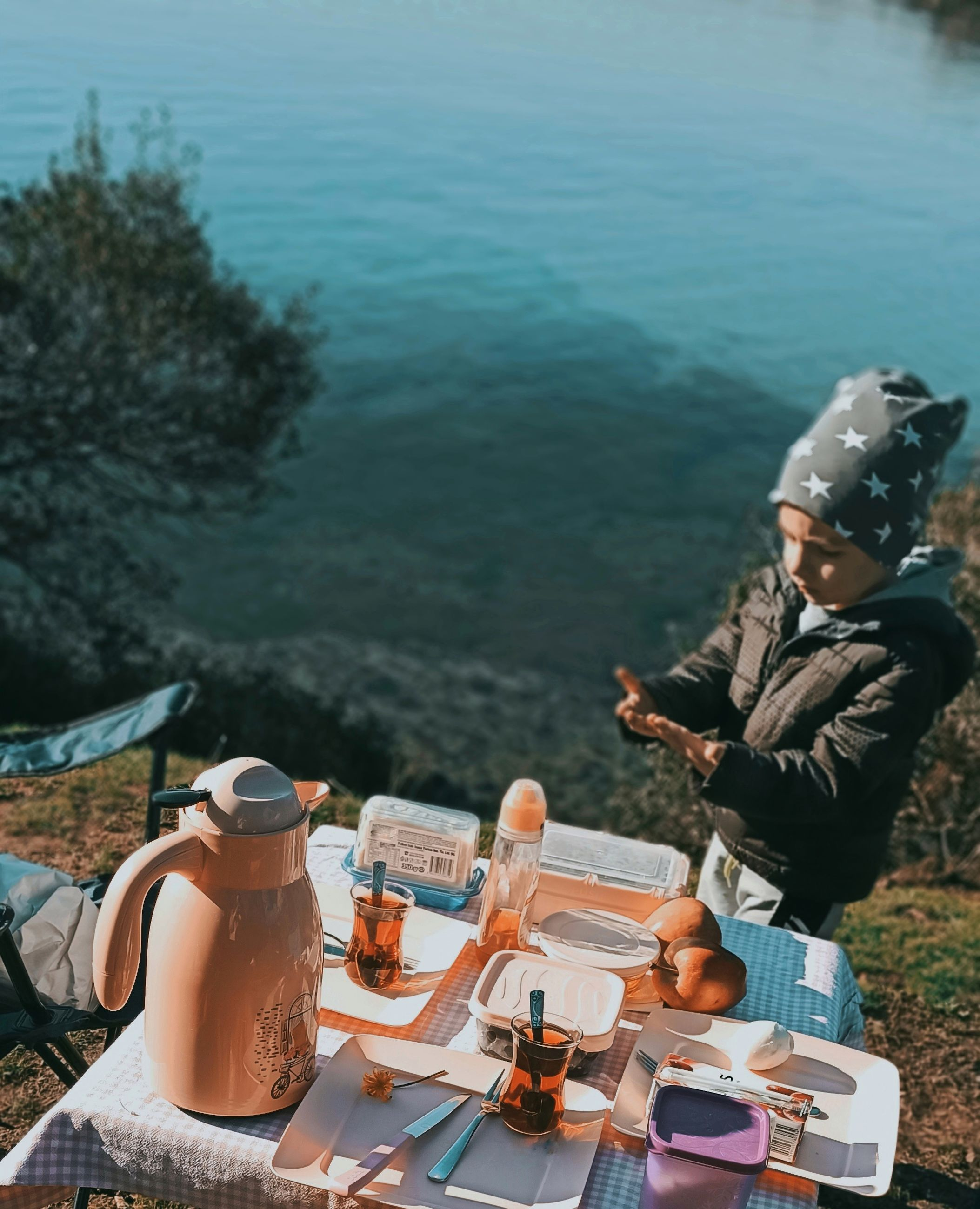 water, nature, sitting, adult, leisure activity, men, high angle view, day, food and drink, relaxation, drink, tree, lake, lifestyles, outdoors, women, plant, land, table, two people, young adult, vacation, refreshment, trip, holiday, full length, togetherness, sunlight, casual clothing