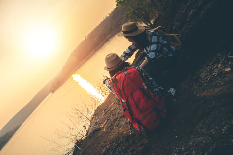 Lifestyles Nature People Outdoors Landscape Backpack Backpacking Backpacker Travel Map Women Sky Sunlight Two People Beauty In Nature Clothing Activity Water Adventure