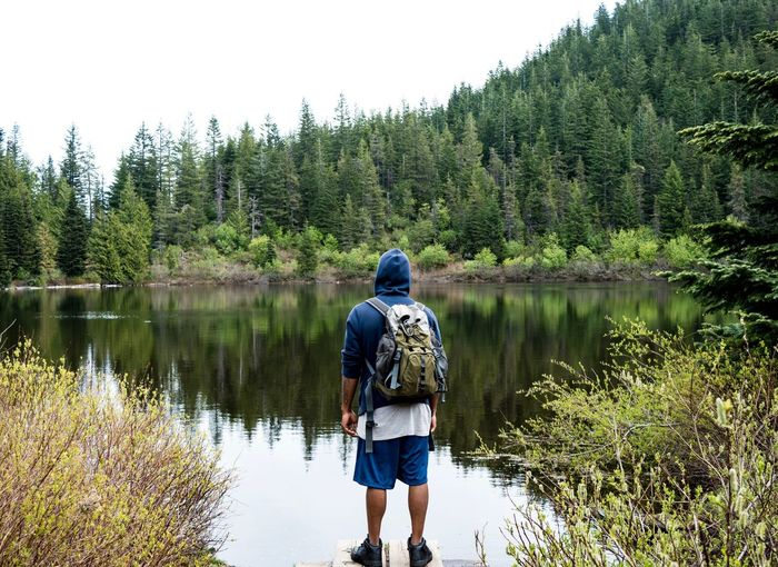 Journey and reflection Rear View Nature Backpack Beauty In Nature Water Lake Forest Exploration Adventure Reflection Scenics Outdoors Tranquility Hiking Real People Live For The Story The Great Outdoors - 2017 EyeEm Awards