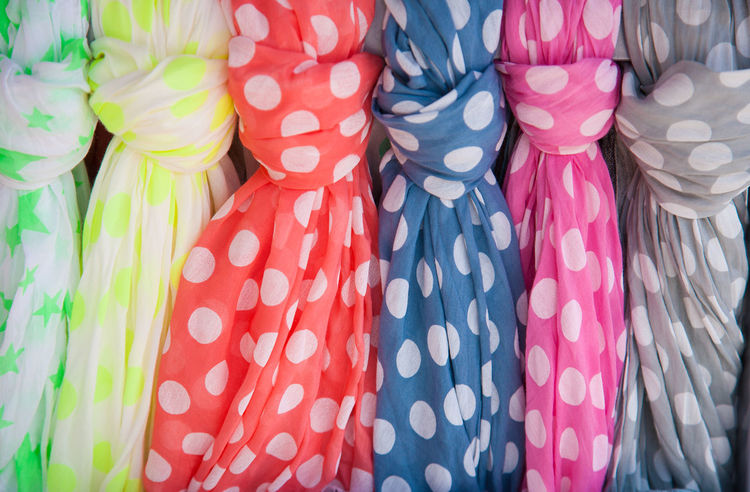 Many colorful dotted cotton summer scarves Hanging Accessory Backgrounds Choice Close-up Clothing Fashion Knot Large Group Of Objects Multi Colored No People Pattern Pink Color Polka Dot Scarf Still Life Summer Textile Variation Wardrobe Wear White Color