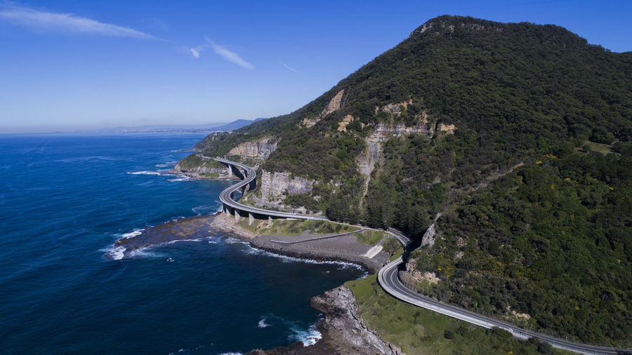 Sea Cliff Bridge DJI X Eyeem Sea No People Nature Water Mountain Outdoors Day Travel Destinations Landscape Scenics Beauty In Nature Vacations Sky Aerial View Blue Beach Tree Nautical Vessel Architecture