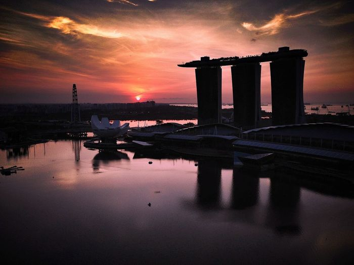 Marina Bay Sands By Sea Against Sky During Sunset In City