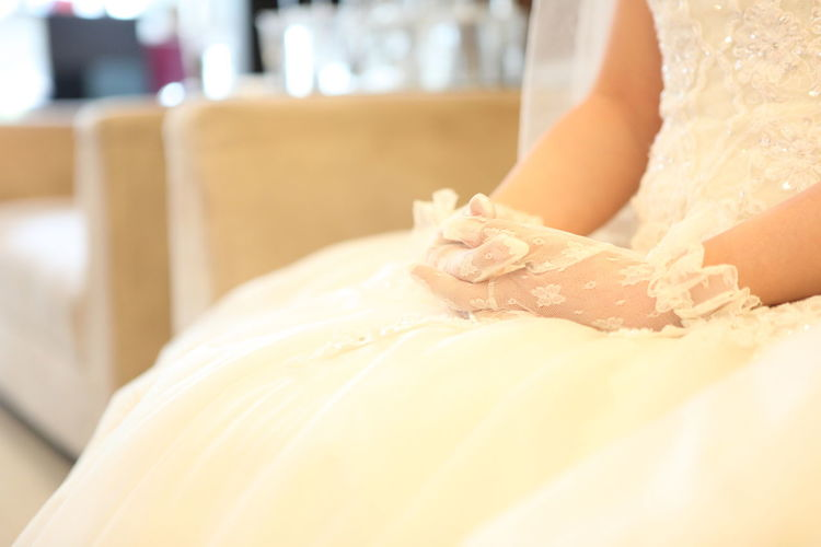 The hand of the bride Human Body Part Human Hand Indoors  Hand One Person Adult Women Body Part Bed White Color Close-up Focus On Foreground Bride Bridegroom Gloved Hand Wedding Wedding Day Wedding Dress